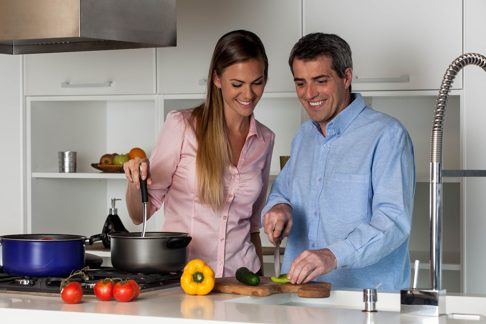 Couple cooking on gas stove top